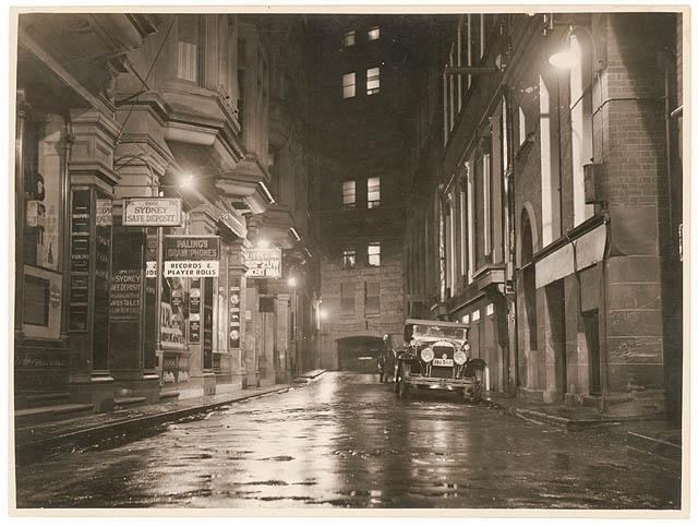 A wet Angel Place, Sydney, 1930s
